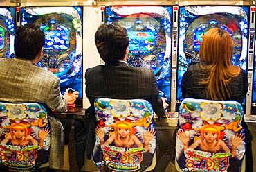 Players at a pachinko parlor in Shibuya district, Tokyo, Japan