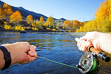 Point of view flyfishing on Big Wood River in Sun Valley, Idaho, USA