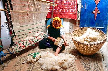 Woman weaving carpet, Tinerhir, Todra valley, South Morocco.