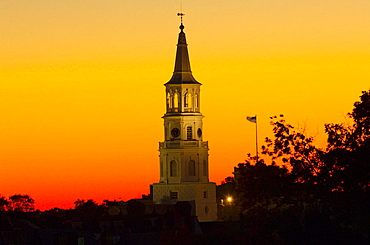 Twilight view of the steeple of St, Michael's Episcopal Church, in the historic district of Charleston, South Carolina