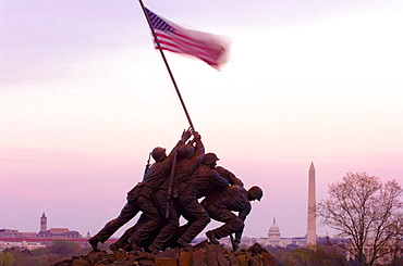 Statue of Marines holding American flag, Iwo Jima Memorial (United States Marine Corps War Memorial), with U, S, Capitol Building and Washington Monument in background,  Arlington, Virginia