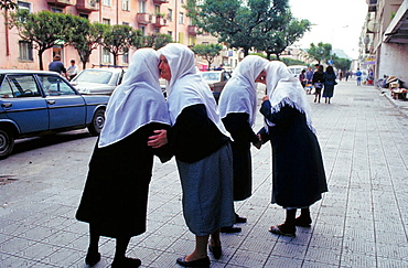 Muslim women: when they meet, they kiss each other on cheeks, according to their custom, Tirana, Albania