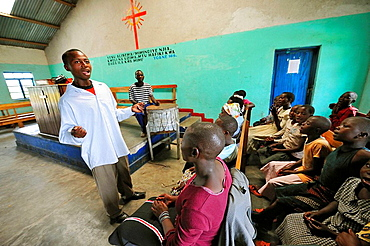 People singing for the church choral at the Lac Vert refugee camp, west of Goma on the road to Sake, North Kivu, Democratic Republic of Congo, Africa