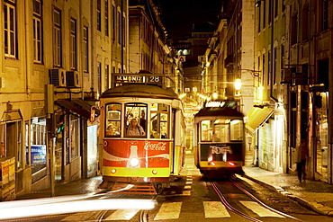 Trams in Baixa district at night, Lisbon, Portugal