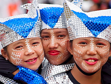 glitter trio,  3 gals with painted faces performing at the annual Sinulog Festival, Cebu, Philippines