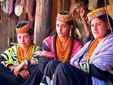 Three Kalasha women on porch, Pakistan