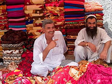 Two blanket vendors in the market in Rawalpindi, Pakistan