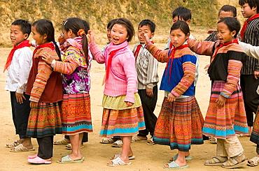Flower Hmong schoolgirls playing in Cau Son near Bac Ha Vietnam