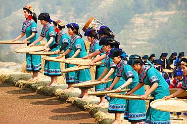Hani Akha women sifting rice at a festival in Yuanyang China