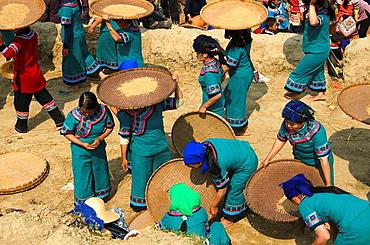 Hani Akha women with their rice sifting baskets in Yuanyang China