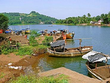 Wooden fishing boats at a small harbor called Bhaucha Dhakka  Chiplun, Ratnagiri, Maharashtra, India