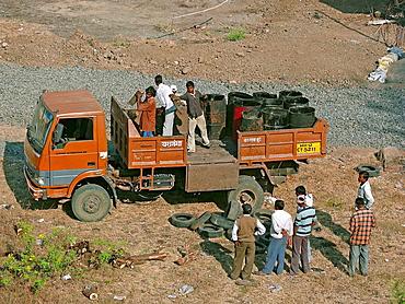 Men working on road construction site  Pune, Maharashtra, India