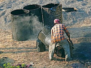 Man working on road construction site  Pune, Maharashtra, India