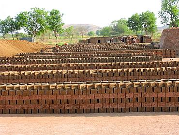 Raw Bricks stacked at a kiln in Nighoj, nigoj, near Shirur, Nagar road, Maharashtra, India