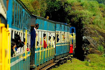 Passengers looking out of the train windows of the Nilgiri Mountain Railway before entering a tunnel during a trip from Ooty to Coonoor, India, Tamil Nadu 2005