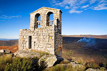 View of the bell tower of San Juan Bautista church  Trevejo  Villamiel  Sierra de Gata  Caceres province  Extremadura  Spain