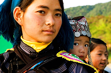 A Hani  Akha woman with her baby