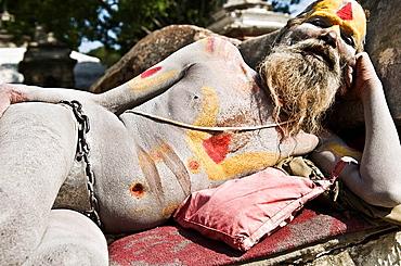 An Indian Naga Sadhu  naked  with an iron belt