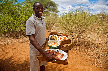 Man presenting lunch in the Tarangire Safari Camp, Tanzania