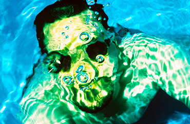 Underwater portrait of a young male