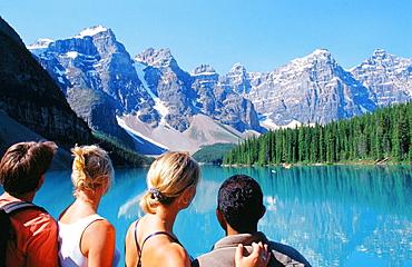 Friends admiring Moraine Lake, Banff National Park, Canada