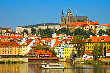 Sightseeing boat in front of Hrad the Prague castle and Mala Strana district in central Prague Czech Republic EU