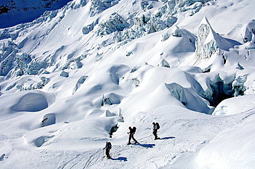 A group of skiers at the glacier Glacier du Geant in the Vallee Blanche, Chamonix, Haute-Savoie, France