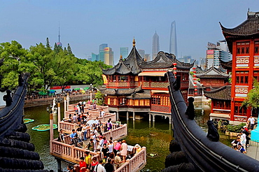 China Shanghai: Yu Yuan Bazar  Zigzag bridge and Huxinting Tea House  Pudong Skyline in Background