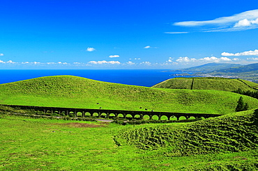 An old aqueduct across the landscape  North coast of Sao Miguel island, Azores, Portugal