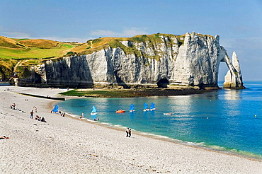 Cliffs, natural arch and stone beach in Etretat, Le Havre, Seine-Maritime departament, Haute-Normandie region, France, Europe