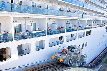 Mechanical mule or electric locomotive guiding Island Princess Cruise ship through Gatun locks, Panama Canal, Panama