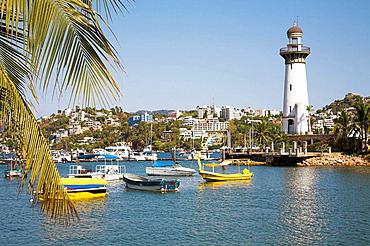 Fishing boats moored off Playa Honda, lighthouse, Acapulco Bay, Acapulco, Guerrero State, Mexico