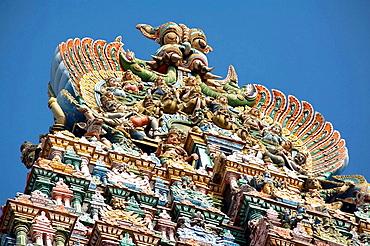 Carved figures on top of a gopuram, Meenakshi Temple, Madurai, Tamil Nadu, India