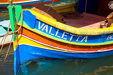 Luzzu fishing boat moored in Marsaxlokk Harbour, Marsaxlokk, Malta