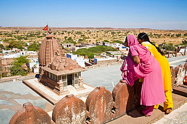 Tourists overlooking a temple within the Sachiya Mata Temple complex, Osian, near Jodhpur, Rajasthan, India