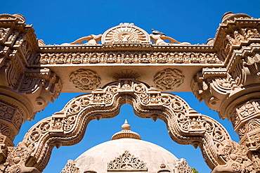Intricate stone carved arch and dome, Mahavira Jain Temple, Osian, near Jodhpur, Rajasthan, India