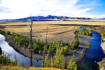 Mongolian landscape with Russian Furgon 4WD vehicle at camp in bend of river, north-central Mongolia No releases available