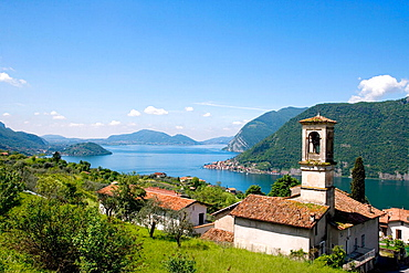 Church near the village of Sale Marasino; the southern part of the lake d'Iseo and Monte Isola Island (the biggest lake island in Europe) can be seen in background, Lombardia, Italy.