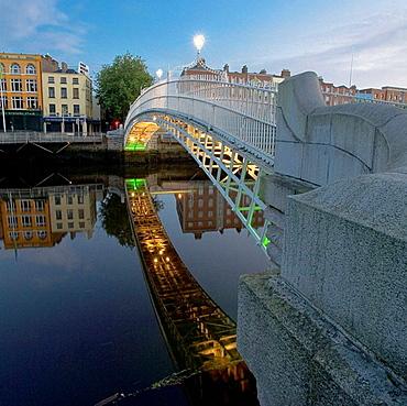 Ireland, Dublin, Half Penny Bridge reflected in River Liffey