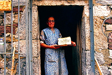 Vega de Uriello, Rosa, one of the last producer of housemade cabrales, with her cabrales (cheese), Picos de Europa, Asturias, Spain.