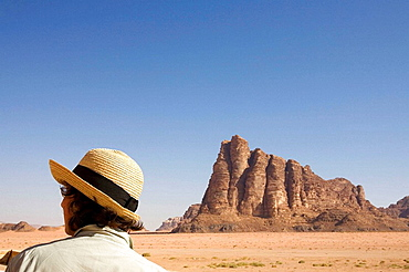 Jordan, Wadi Rum Desert Woman tourist at The Seven Pillars of Wisdom This are the most famous mountains of Wadi Rum, which owes its name to TE Lawrences book,inspired during his stay here