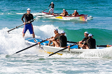 Surfboat teams racing at Cronulla Beach, as part of a surf lifesaving carnival  Sydney, New South Wales, Australia
