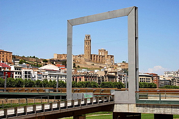 Seu Vella (old cathedral) framed by new design element in Placa Blas Infante by Segre river, Lleida, Segria, Catalonia, Spain