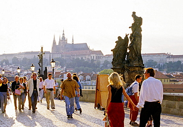 Tourists at Charles Bridge view on Prague Castle in Prague, Czech Republic
