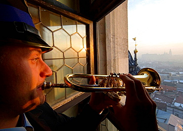 Poland Krakow Every hour trumpeter plays anthem from St Marys Church Tower
