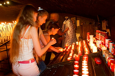 Pilgrims in the Crypt of the Black Virgin, annual gipsy pilgrimage at Saintes-Maries-de-la-Mer, Camargue, France