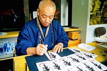 Priest doing calligraphy, Nikko, Japan