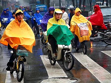 China, Jiangsu Province, Suzhou, communters on motorcycles