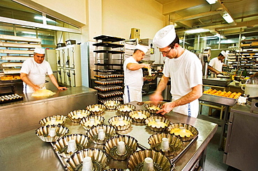 Scaturchio' pastry shop, cooks making the 'baba' (typical yeast cake), Naples, Campania, Italy