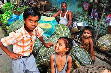 Boys at the vegetable market, New Delhi, India